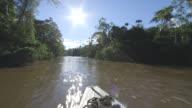 WS POV View of sun shines as boat going down Amazon river / Peru
