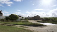WS View of Sun shining over local homes in fishing village / Aniston, Western Cape, South Africa