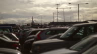 WS T/L View of Sunny winters day at Luton International airport with full car parking with planes moving in back side and moving clouds / Luton, Bedfordshire, United Kingdom