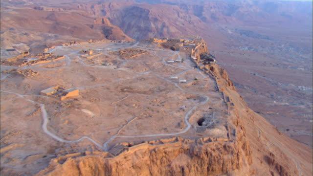 AERIAL ZI TS View of sunrise at masada / Sourn Judea Desert, Israel