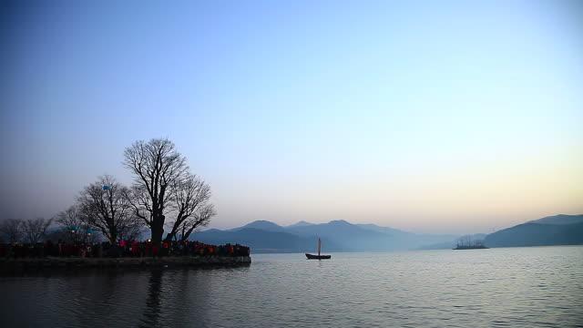 WS View of Sunrise ceremony at Dumulmeori (Place that joins Bukhangang River between Namhangang River, Famous place for its view) with sailing boat AUDIO / Yangpyeonggun, Gyeonggido, South Korea
