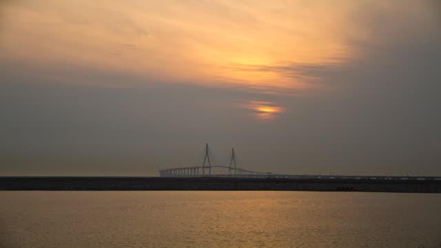 WS T/L View of sunset over Incheon Bridge / Incheon, South Korea