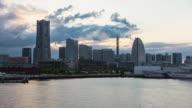 WS T/L View of sunset over Minato Mirai offices and shopping building complex in Yokohama / Yokohama, Kanagawa, Japan