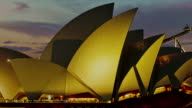 MS PAN T/L View of sunset over opera house / Sydney, Australia