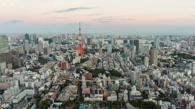 WS T/L View of sunset over Tokyo tower / Tokyo, Japan
