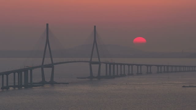 WS T/L View of Sunset scene of Incheon Grand Bridge (is South Korea's longest spanning cable-stayed bridge ) / Incheon, South Korea