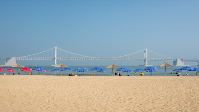 View of sunshade and vacationer who visiting  Gwangalli Beach