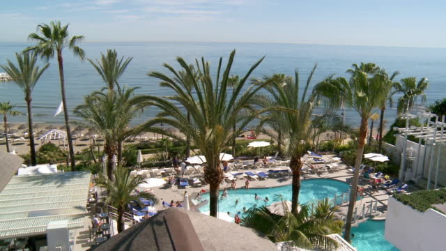 MS View of swimming pool and beach / Marbella, Andalusia, Spain