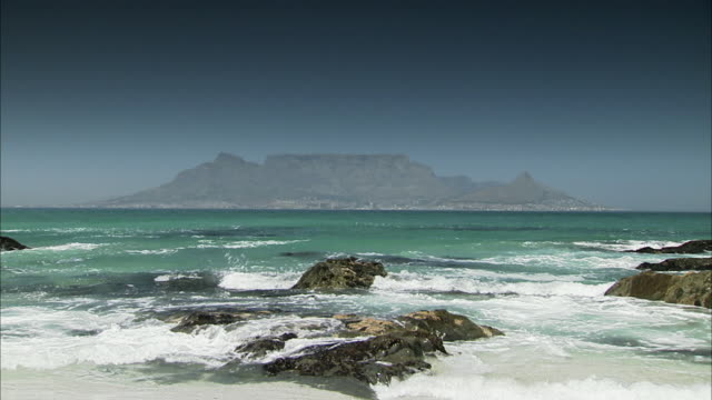WS View of Table Mountain with breaking waves in foreground / Cape Town, Western Cape, South Africa