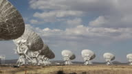 WS PAN View of telescope of radio atennas in large field / San Agustin, New Mexico, United States
