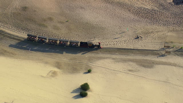 MS AERIAL ZO PAN ZI View of Thalys Train across dunes / Picardy, France