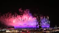 view of the 2012 London Olympic Opening Ceremony from a nearby vantage point / The Olympic Stadium and the Arcelor Mital Orbit Tower are illuminated...