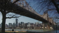 A view of the 59th Street Queensboro Bridge taken from Queens looking at Manhattan the East River is flowing below.