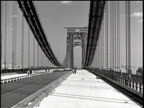 View of the bridge and Hudson river / a zeppelin flies over the bridge / a city view from the bridge / moving shot straight across the bridge /...