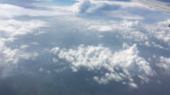 View of the clouds from airplanes window during the flight