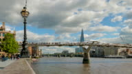 View of the Millennium bridge with the Shard building in the background