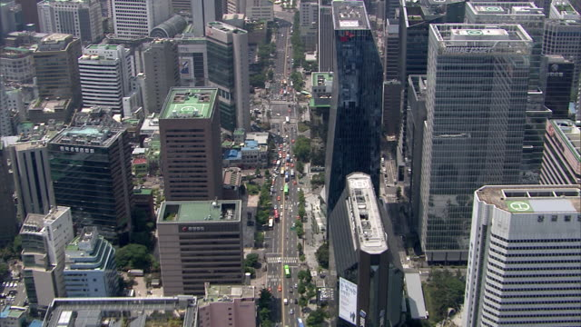 AERIAL View of the skyscrapers and traffic at downtown district of Seoul City