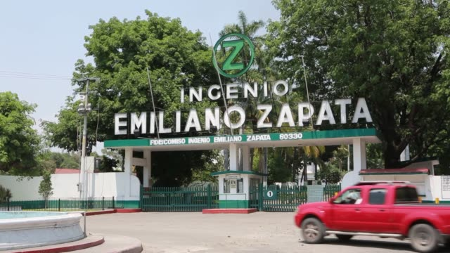 View of the smokestacks of the Emiliano Zapata refinery in Zacatepec Mexico Shots of signage above the main entrance to the Emiliano Zapata Refinery...