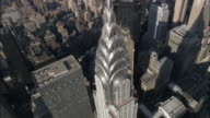 AERIAL PAN View of the spire of the Chrsyler Building / New York, New York, USA