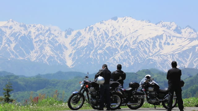 WS View of Three middle-aged bike rider and Hida Mountains / Hakuba, Nagano Prefecture, Japan