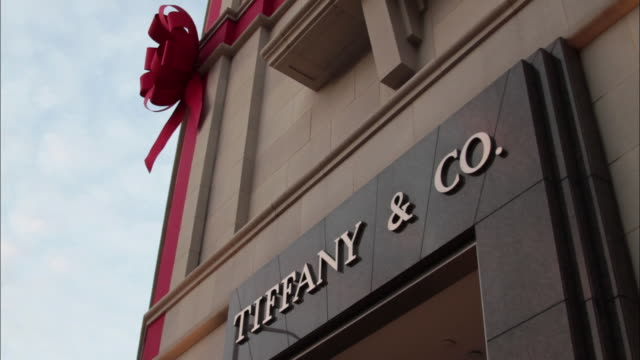 CU View of Tiffany & Co storefront with red ribbon / Beverly Hills, California, USA