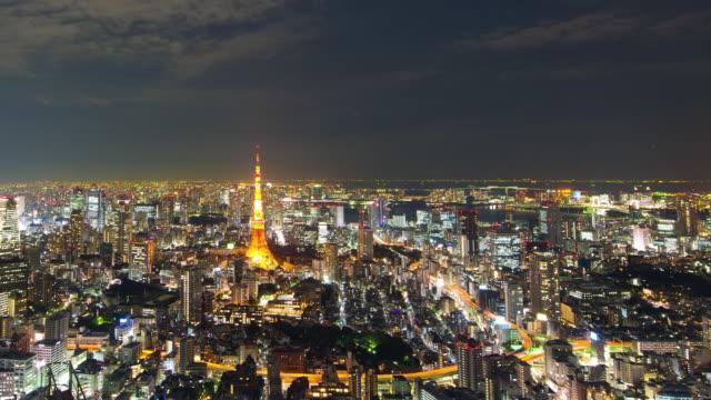 WS T/L View of Tokyo tower and city at night / Tokyo, Japan
