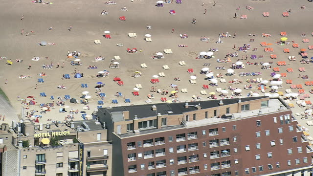 MS AERIAL ZO ZI View of tourist enjoying on Beach at Blankenberge / Flanders, Belgium