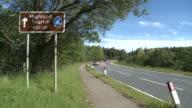 MS View of tourist sings board near raod / Speybridge, Speyside, Scotland