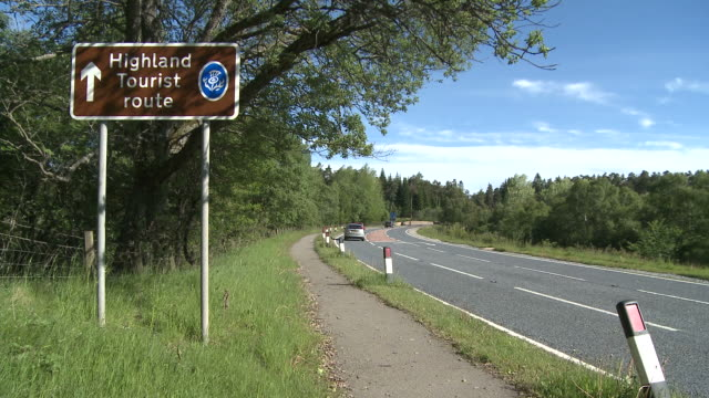MS View of tourist sings board near raod / Speybridge, Speyside, Scotland