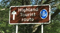 MS View of tourist sings board / Speybridge, Speyside, Scotland