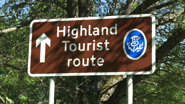 MS View of tourist sings board / Speybridge, Speyside, Scotland