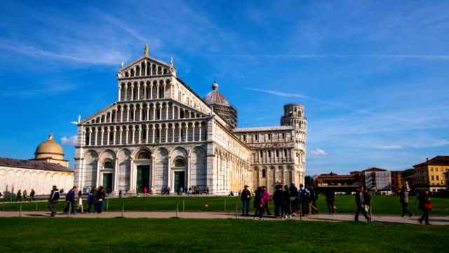 View of tourists at facade of Pisa Cathedral (the third oldest structure in the city's Cathedral Square) and the Leaning Tower of Pisa