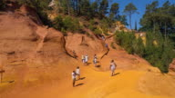 WS View of tourists at Ocre Canyon / Roussillon, Provence, France