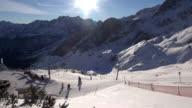 WS View of tourists skiing at Alpspitze Werdenfelser Land with snow mountains / Garmisch Partenkirchen, Bavaria, Germany