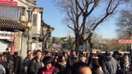 A view of Tourists tour Hutong Alley on Feb 9 2017 at famous Nanluoguxiang Beijing China