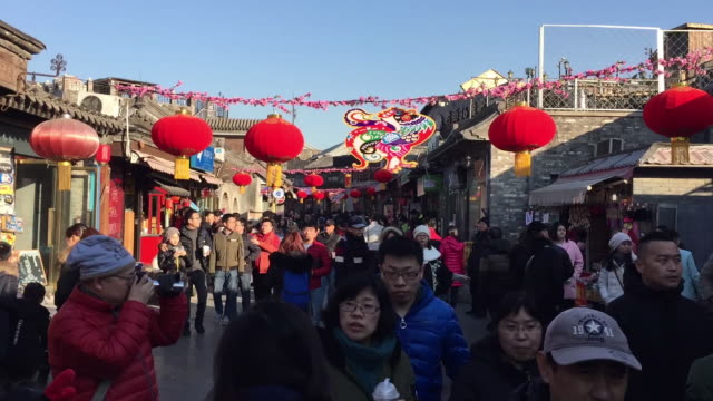 A view of Tourists tour Hutong Alley on Feb 9 2017 at famous Houhai Beijing China