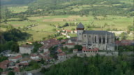AERIAL, View of town and cathedral, Saint-Bertrand-de-Comminges, Haute-Garonne, France