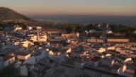 WS View of town at sunset coastline / Mijas, Spain