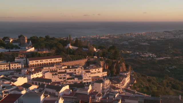 WS View of town at sunset coastline / Mijas, Spain