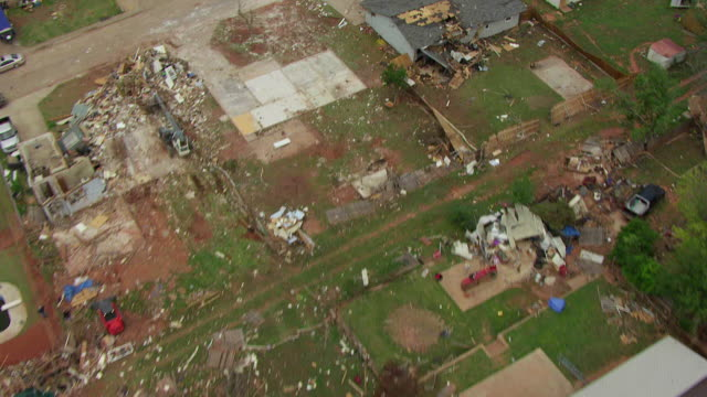 WS AERIAL View of Town buildings demolished in path of tornado / Woodward, Oklahoma, United States