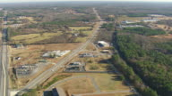 WS AERIAL View of townscape and Route 72 out of Athens / Georgia, United States