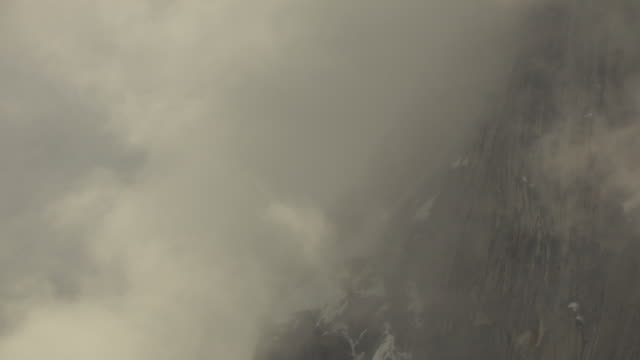 CU AERIAL TU View of tracking ridge of Ruth Gorge with clouds / Alaska, United States