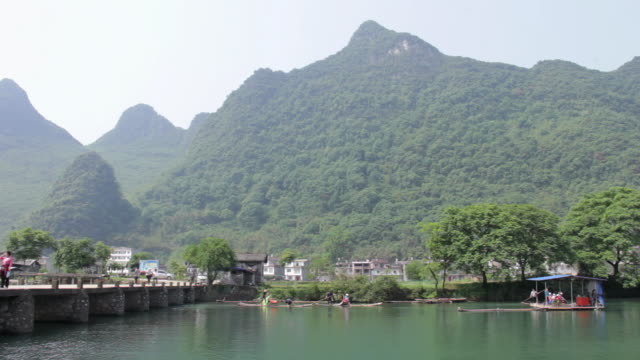 WS View of Traditional boats moving ahead river / Close to Li River, Guangxi, China