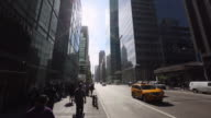 WS TU View of traffic and sun beside skyscraper at Avenue of America / New York, United States