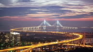 WS T/L View of traffic moving on Incheon Bridge in Songdo Business District (new town) at night / Incheon, South Korea