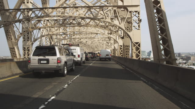 WS POV View of traffic moving on Queensborough Bridge / New York, United States