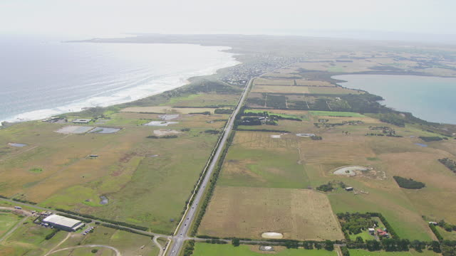 WS AERIAL ZI TD View of traffic moving on road near ocean at Pyramid Rock / Phillip Island, Victoria, Australia