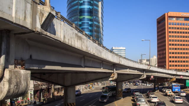 View of traffic moving under the Ahyeon Overpass
