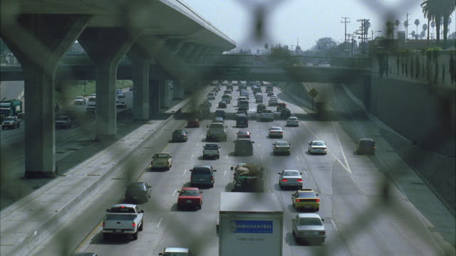 WS View of traffic on expressway through fence / Los Angeles, California, USA