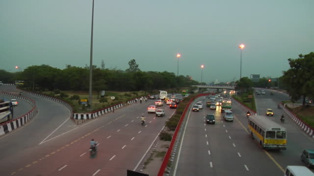 WS T/L View of traffic on flyover / Delhi, India